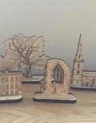 Artistic sculptures of buildings in Ticknall.