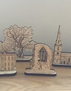 Hand drawn laser cut buildings